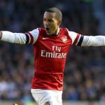 Theo Walcott celebrates scoring for Arsenal