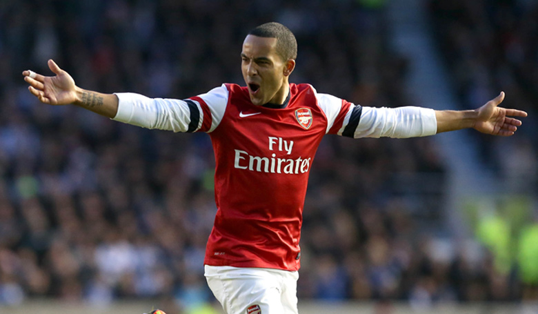 Theo Walcott celebrates scoring for Arsenal